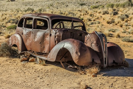heist: Old car wreck used in diamond theft in Namibia, riddled with bullet holes.