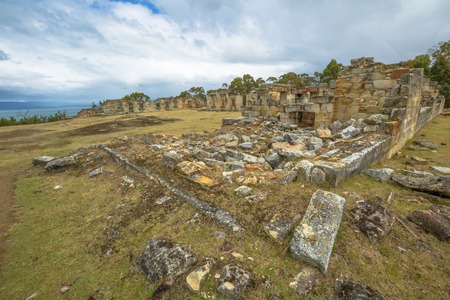 barracks: Overview of Coal Mines Historic Site c.1833, Saltwater River, Tasmanian Peninsula, Tasmania, Australia. Today, you may visit the picturesque ruins of houses, barracks, offices and punishment cells.