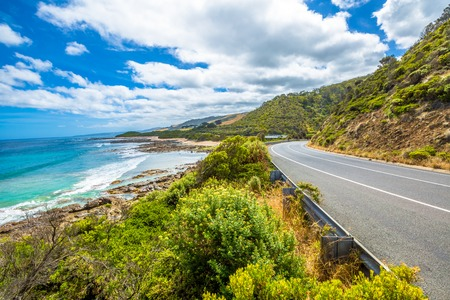 Great Ocean Road with its famous mountains, the winding road, cliffs, rocky beaches, the turquoise sea and its waves for surfing.