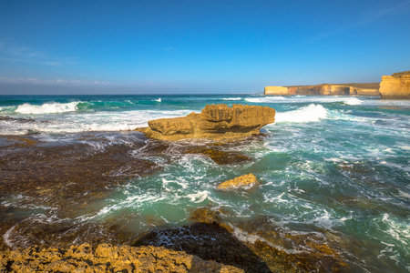 sculpted: Stormy sea of Sherbrooke River Beach, Loch Ard Gorge, one of main attractions of Port Campbell National Park world famous for its collection of wave sculpted rock formations and the Twelve Apostles.