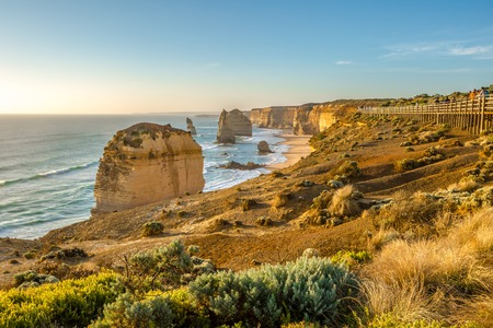 comprise: Panoramic view of the stacks that comprise the Twelve Apostles at sunset, one of the main attractions of the Port Campbell National Park. Great Ocean Road, Victoria State, Australia.