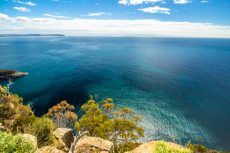 fluted: Spectacular views of the cliffs, ocean and Penguin Island during the trek Fluted Cape within the South Bruny National Park Bruny Island, Tasmania Australia. .