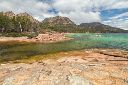 granite park: Honeymoon Bay is located near Coles Bay in Freycinet Peninsula. Freycinet National Park, is a paradise of pink granite mountains, white beaches and turquoise sea on Tasmanias east coast, Australia.