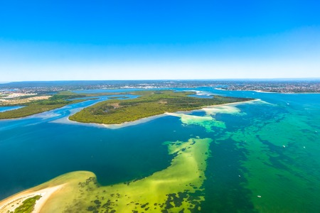 foreshore: Aerial reef view of Bate Bay located south of Sydney, New South Wales, in eastern Australia. The bay is south of the Kurnell peninsula and its foreshore makes up the beaches of Cronulla. Stock Photo