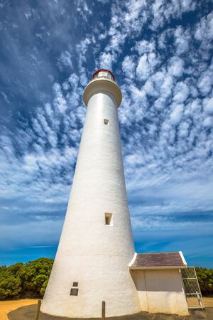 split road: Split Point Lighthouse with blue sky located in Aireys Inlet on the Great Ocean Road, Victoria, Australia. .