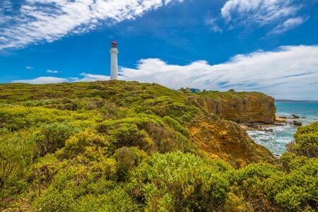 inlet: Split Point Lighthouse with blue sky located in Aireys Inlet on the Great Ocean Road, Victoria, Australia. .