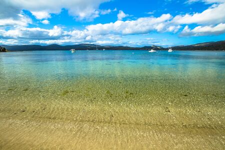 clear away: White Beach Tourist Park in Wedge Bay to only 10 minutes away from the popular Port Arthur Historic Site is a popular beach with crystal clear water and white sand. Stock Photo