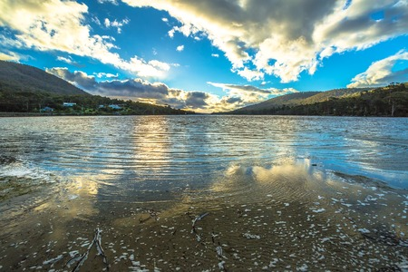 tasman: Wild landscapes with clouds reflected in the water, in Tasman Peninsula in South Eastern Tasmania, Australia. Stock Photo