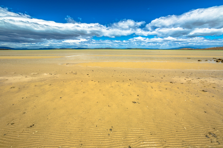 tasman: Spectacular low tide at Dunalley Bay where the clouds reflected in the water, in the Tasman Peninsula, south east coast of Tasmania, Australia. Stock Photo