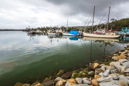 helens: The fishing boats in the port of St Helens, Georges Bay, Tasmania, Australia. St Helens is the most important city of the northeast coast and is famous for the Bay of Fires. Stock Photo