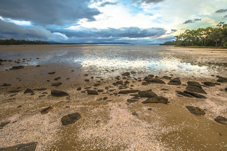 daniels: Daniels Bay, Lunawanna, Bruny Island, Tasmania, Australia. Clouds in the sky reflected on the water.