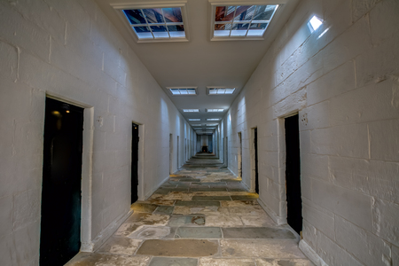 corridors: Port Arthur Historic Site, Tasmania, Australia - January 15, 2015: Corridors of the Separate Prison. Each of the four wings comprised a central corridor flanked by rows of solitary confinement cells.