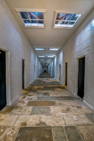 corridors: Port Arthur Historic Site, Tasmania, Australia - January 15, 2015: Corridors of the Separate Prison, each of the four wings comprised a central corridor flanked by rows of solitary confinement cells. Editorial