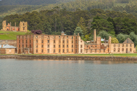 penal: The Penitentiary in Port Arthur Historic Site, Which until 1877 was a penal colony for prisoners. The site is located on Tasman Peninsula, Tasmania, Australia. View from boat.