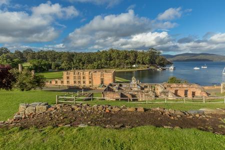 tasman: Overlooking guard tower and penitententiary from behind in Port Arthurs historic convict settlement, in the Tasman Peninsula, Tasmania, Australia. . Stock Photo