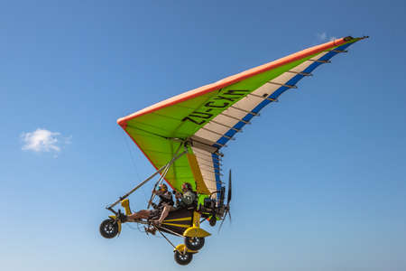 kwazulu natal: KwaZulu-Natal, South Africa - August 26, 2014:  Flight with the instructor and photographer on a ultralight aircraft on African landscape and ocean