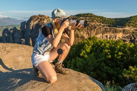 kalabaka: A travel photographer takes pictures of the spectacular monasteries of Meteora, Central Greece. Panoramic view from the best existing view point, a rock called Psaropetra.