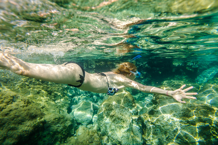 mani: Female snorkeling in the famous Foneas Beach, Kardamili in Mani peninsula, Peloponnese, Greece. Stock Photo