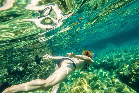 free dive: Female snorkeling in the famous Foneas Beach, Kardamili in Mani peninsula, Peloponnese, Greece. Stock Photo