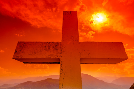 pontiff: Dramatic sky scenery at sunset with a closeup of the Christian cross. Symbol of hope, salvation and the Jubilee of Mercy, Rome Holy Year 2015. Stock Photo