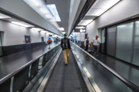 blur effect: Business man moves to the gates at the airport on escalator. Blur effect. Stock Photo
