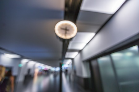 corridors: Closeup of clock in the corridors of an airport with blur effect. Abstract airport background.