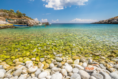 mania: Kokkala Beach, Mania Peninsula, Lakonia, Peloponnese, Greece, a beautiful stone beach with a transparent and turquoise sea.