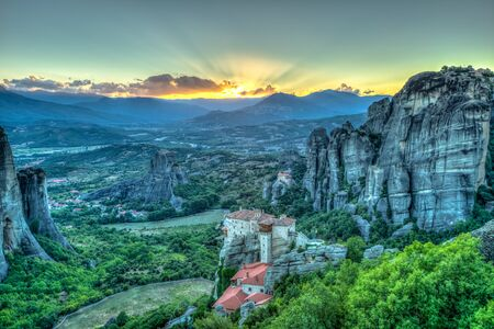 kalambaka: Spectacular colorful sunset over the valley of Meteora, from the best view point, a rock called Psaropetra, Kalambaka, Meteora, Central Greece. Stock Photo