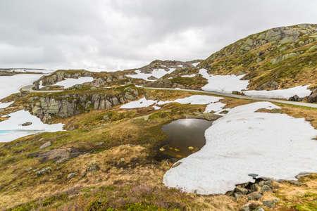 fv: Norway mountain lake landscape. Lysevegen scenic road in winter FV 500: Sirdal to Kjerag, Norway, Europe.