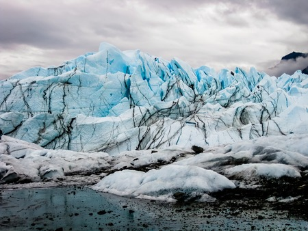 frozen river: Spectacular river water caused by the melting of the Matanuska Glacier in summer, Matanuska Glacier State Recreation Area, just two hours from Anchorage in Alaska, USA.