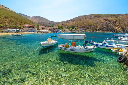 Fishing boats in the clear tropical waters of Porto Kagio, Mani Peninsula, Lakonia, Peloponnese, Greece.