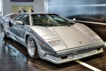 lamborghini: Guglielmo Marconi Airport, Bologna, Italy - August 31, 2015:  vintage luxury Lamborghini Countach produced from 1974 to 1990 on exposition at Bologna Airport for 100 years hystory of Lamborghini. Editorial