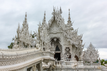 The spectacular Wat Rong Khun called White Temple during the rainy season, Chiang Rai, Northern Thailand, Asia. Stock Photo