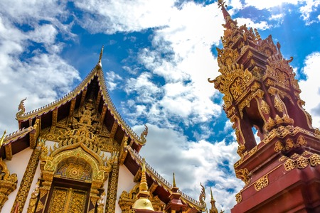 ornately: An ornately decorated and gilded Buddhist temple, Wat Monthian, in the old city of Chiang Mai, Northern Thailand, Asia. Stock Photo
