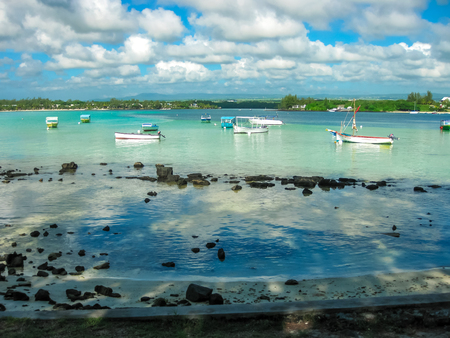 Blue Bay Beach and its boats in the bay, Grand Port, Mauritius, Indian Ocean.