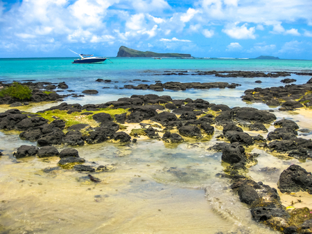 The spectacular beach of Malheureux a small fishing village with a beautiful clear blue waters. Located at the northernmost tip of the country near Grand Baie. In the background, Coin de Mire. Stock Photo - 47469821