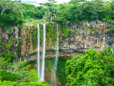 aux: The Chamarel falls, 100 meters high, the most famous waterfalls in Mauritius at a short distance from the colored earth, Mauritius, Indian Ocean. Stock Photo