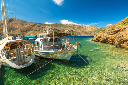 mani: Fishing boats in the clear tropical waters of Porto Kagio, Mani Peninsula, Lakonia, Peloponnese, Greece.
