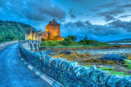 lochs: Dornie, Kyle of Lochalsh, Scotland, United Kingdom - May 31, 2015:Eilean Donan Castle at night, Dornie, Kyle of Lochalsh in Scotland, United Kingdom. It is the most visited castle, situated on an island at the confluence of three sea lochs.