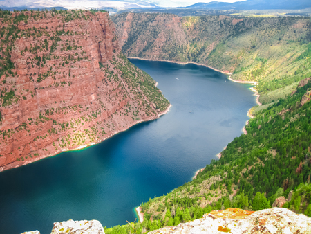 river: Aerial view of Flaming Gorge National Recreation Area located between Utah and Wyoming, a reservoir on the Green River, created by Flaming Gorge Dam located in the United States.