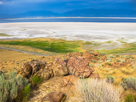 Aerial view of the dramatic landscape of the Great Salt Lake on Antelope Island State Park, also called land of Buffalo, Salt Lake, Utah, United States.