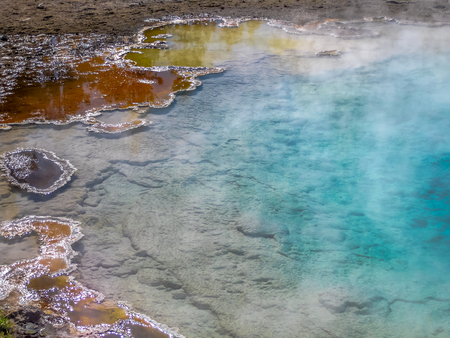 Closeup hot spring with steam in Yellowstone National Park, Wyoming and Montana, United States.
