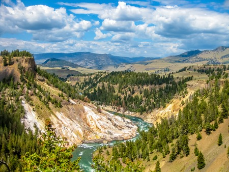 lower yellowstone falls: Lower Falls, most popular waterfall in Yellowstone, are sits in head of the Grand Canyon in Yellowstone River. The yellow rocks gave name of Yellowstone National Park, Wyoming, United States.