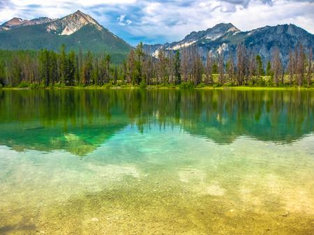 sawtooth national forest: Spectacular landscape of Sawtooth National Forest which is reflected in Alice Lake, heart of Idaho, United States.