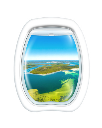 vehicle window: Aerial view of reef in Bate Bay south of Sydney, New South Wales, in eastern Australia from a plane through the porthole window. Copy space.