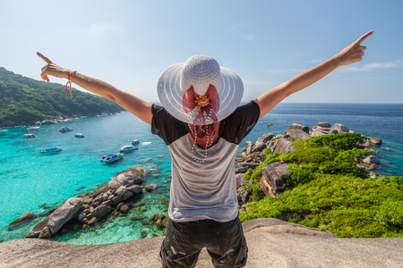 similan islands: Happy tourist enjoys panorama from Sail Rock View Point of kor 8 of Similan Islands National Park, Phang Nga, Thailand, one of the tourist attraction of the Andaman Sea.