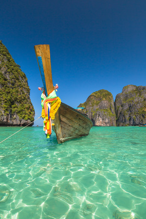 phi phi: Long Tail Boat, traditional wooden boat, at Maya Bay lagoon of famous movie The Beach with Leonardo DiCaprio, Phi Phi Leh, Andaman Sea in Thailand. Copy space.