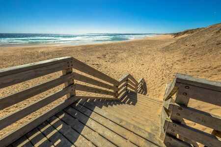 miller: Wooden boardwalks to the beach of Kitty Miller Bay at sunset, in Phillip Island, Victoria, Australia. Stock Photo
