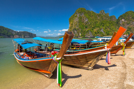phang nga: Long Tail Boat, traditional wooden boats, in James Bond island, Khao Phing Kan, Phang Nga Bay, Ao Phang Nga National Park, Krabi Province, Thailand.