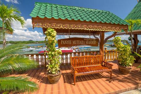panyi: Ao Phang Nga National Park, Krabi, Thailand - January 6, 2016: The Panyee Muteara Seafood, in historical floating Koh Panyi settlement, also known as Koh Panyee, muslim fishing village built on stilts